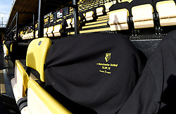 A general view of a commemorative match t-shirt in the stands prior to the match between Watford and Manchester United