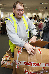 Man with a mild learning disability working as a factory cleaner, shown here recycling cardboard boxes,helped into employment by the Ready 4 Work team, Nottinghamshire County Council
