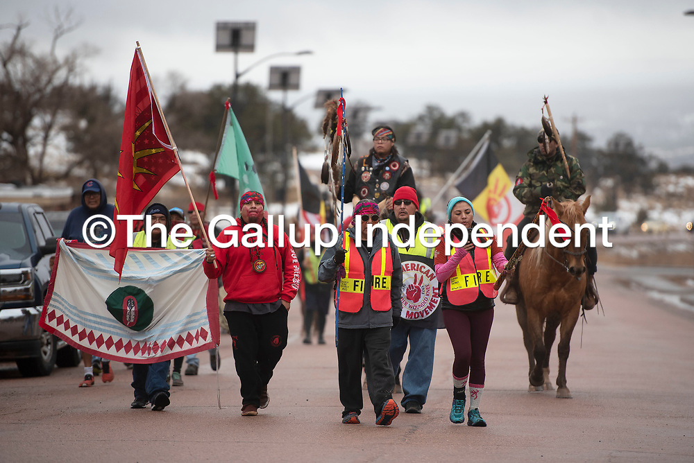 Participants of the Diné Missing and Murdered Indigenous People Sunrise Prayer Run walk into the tribal park Tuesday, Jan. 21 in Window Rock. The 250-mile prayer run began in Flagstaff on Friday Jan. 17 and ended at the Window Rock Tribal Park Tuesday Jan. 21.