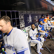 Josh Donaldson, Toronto Blue Jays, exercising with a medicine ball watched by Jose Reyes, in the dugout during the New York Mets Vs Toronto Blue Jays MLB regular season baseball game at Citi Field, Queens, New York. USA. 15th June 2015. Photo Tim Clayton