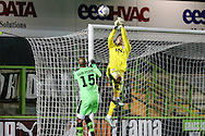 Bristol City goalkeeper Max O'Leary punches the ball clear during the The County Cup match between Forest Green Rovers and Bristol City at the New Lawn, Forest Green, United Kingdom on 23 November 2015. Photo by Shane Healey.