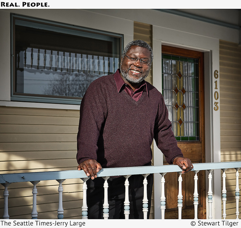 Seattle Times columnist Jerry Large standing on a porch.  Ad for the Seattle Times.