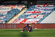 AFC Wimbledon defender Paul Kalambayi (30) sitting on own after final whistle during the EFL Sky Bet League 1 match between AFC Wimbledon and Plymouth Argyle at the Kiyan Prince Foundation Stadium, London, England on 19 September 2020.