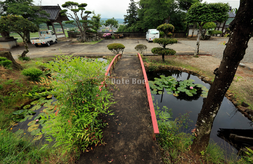 little garden with pound and bridge Japan