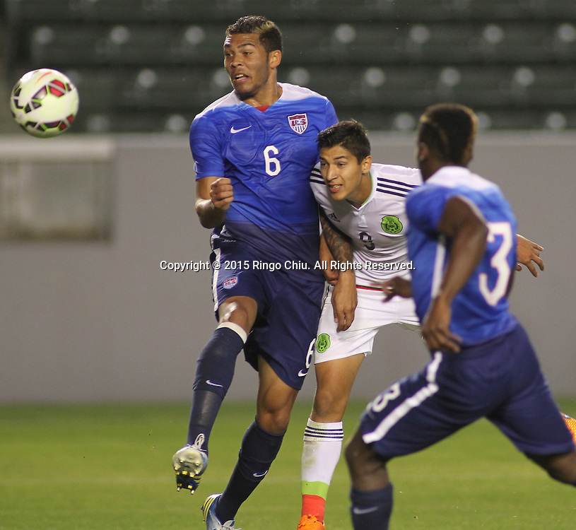 United States' Christian Dean #6 actions against Mexico's §ngel Zaldivar #9 during a men's national team international friendly match, April 22, 2015, at StubHub Center in Carson, California. United States won 3-0. (Photo by Ringo Chiu/PHOTOFORMULA.com)