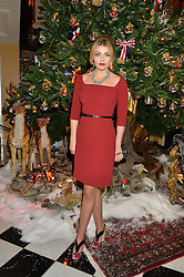 LOLA LENNOX at a party to celebrate the unveiling of the 2014 Claridge's Christmas tree by Dolce & Gabbana at Claridge's, Brook Street, London on 19th November 2014.