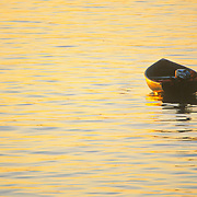 A dinghy on its mooring at sunrise. Rockland, Maine