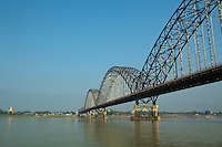 Ava Bridge spanning the Irrawaddy River- also spelt Ayeyarwaddy is a river that flows from north to south through Burma. It is the country's largest river and most important commercial waterway. Originating from the N'mai and Mali rivers, it flows North-South before emptying into the Irrawaddy Delta and finally the Andaman Sea. After Rudyard Kipling's poem, it is sometimes referred to as 'The Road to Mandalay'..The river is vital as a considerable amount of cargo and traffic moves by river.