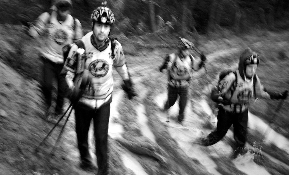 The British Team Helly Hansen Prunesco treking in the mud in Patagonia, Chile, South America while competing in the 2009 Wenger Patagonia Expedition Race. .Copyrighted work .Permission must be sought before use of this image..Alex Ekins .0114 2630277.07901883 994