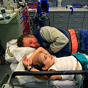 Ulisses Cavazos, 7, lays on a medical bed with his father, Moises, while receiving chemotherapy at Driscoll Children's Specialty Center in Brownsville. Ulisses underwent two surgeries and radiation therapy in August for a brain tumor, but the cancer has spread to other areas in the young boys body. <br /> Nathan Lambrecht/The Monitor