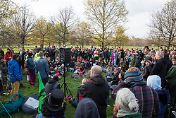 London, UK. 14th April 2019. A police officer liaises with climate campaigners from Extinction Rebellion, some of whom had walked from as far away as Land's End on the 'Earth March', gathered in Hyde Park to prepare for 'International Rebellion UK - Shut Down London!' events next week to call on the Government to take urgent action to address climate change.