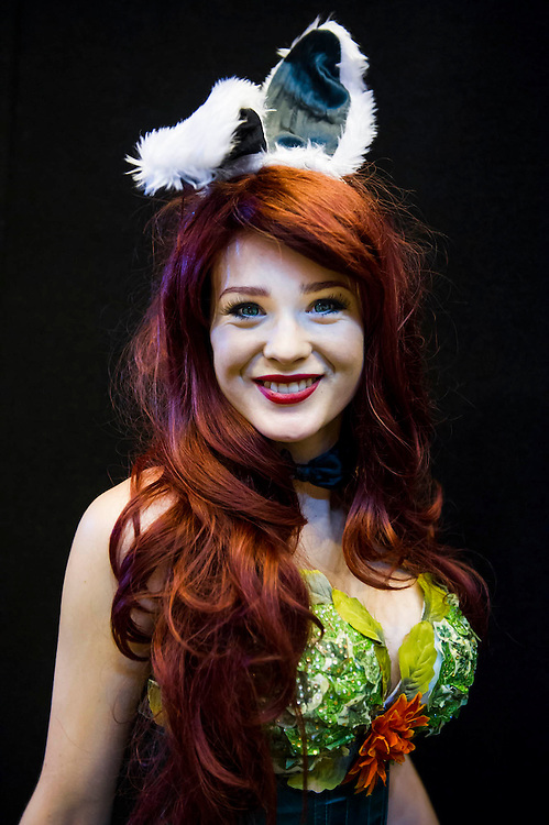 Stephanie Kaye, 19 from Bath, plays (Funny)Poison Ivy. She enjoys creating the costumes and the attention they get at such conventions, but sometimes finds there popularity means she gets trapped by 'hordes' of people wanting to take her picture. London Film and Comic Con 2014, (LFCC), at Earls Court, London, UK.