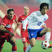 Turkey's Hamit ALTINTOP (L) and South Korean's Park Chu-YOUNG (R) during their International friendly soccer match Turkey between South Korean at the Avni Aker stadium in Trabzon, Turkey on Wednesday 09 February 2011. Photo by TURKPIX