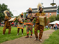 The Akwaaba Ensemble Abou Sylla, Mary Sosu, Theo Martey and David Nyadedzor perform traditional Ghanian drum and dance at Rotary Park during Laconia's Multicultural Festival on Saturday.  (Karen Bobotas/for the Laconia Daily Sun)