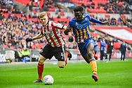 Elliot Whitehouse of Lincoln City (4) and Aristote Nsiala of Shrewsbury Town (22) battle for the ball during the EFL Trophy Final match between Lincoln City and Shrewsbury Town at Wembley Stadium, London, England on 8 April 2018. Picture by Stephen Wright.