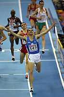 Photo: Rich Eaton.<br /> <br /> EAA European Athletics Indoor Championships, Birmingham 2007. 03/03/2007. Cosimo Calindro of Italy wins the mens 3000m final with Mo Farah of Great Britain some distance behind