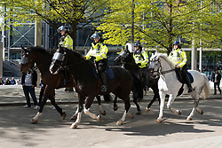 © Licensed to London News Pictures. 15/05/2021. London, UK. Mounted police officers patrol Wembley Stadium hosting the Emirates FA Cup Final between Chelsea football club and Leicester City football club. All attendees have to show evidence of a negative Covid-19 test to attend the event as part of the Events Research Programme (ERP) pilot scheme informing the government's decision on step 4 of its roadmap out of lockdown. Photo credit: Ray Tang/LNP