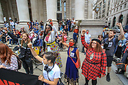 """Activist from Black Lives Matter movement Marvina Newton delivers a speech during an Extinction Rebellion fifth day of two-week protest campaign outside the Bank of England in London on Friday, Aug 27, 2021.<br /> Activists said that the wealth of this country is """"blood wealth"""" as to this day the country use its financial and armed power to exploit resources elsewhere. (VX Photo/ Vudi Xhymshiti)"""