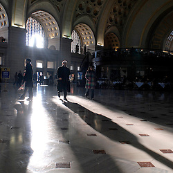 WASHINGTON, DC- Afternoon commuters' cast long shadows in the main terminal of Union Station.  ..Photo by Susana Raab