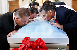 © Licensed to London News Pictures. 21/04/2018. Cobham, UK. Paddy <br /> Doherty (r) and his brothers kiss the coffin of their mother Queenie, Elizabeth Doherty at Sacred Heart Church in Cobham, Surrey. Elizabeth Doherty, whose son Paddy Doherty is known for appearing on My Big Fat Gypsy Wedding and winning Celebrity Big Brother 8, died of a heart attack earlier this month. Paddy Doherty claimed his mother has died of a 'broken heart' following the death of her husband almost a year ago. Photo credit: Peter Macdiarmid/LNP