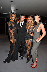 Left to right, JOURDAN DUNN, JONATHAN SAUNDERS, CARA DELEVINGNE and DAISY LOWE at the GQ Men Of The Year 2014 Awards in association with Hugo Boss held at The Royal Opera House, London on 2nd September 2014.