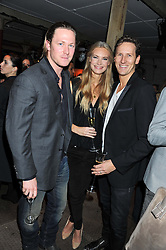 Left to right, ARTHUR LANDON, and BRENDAN & ZOE COLE at a party to celebrate the launch of the new Vertu Constellation phone - the luxury phonemakers first touchscreen handset, held at the Farmiloe Building, St.John Street, Clarkenwell, London on 24th November 2011.