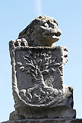 lion statue with tree on coat of arms decorating the university building Valladolid spain castile and leon