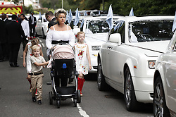 © Licensed to London News Pictures. 21/08/2018. Ashtead, Surrey. Mourners arrive at St Michaels Church in Ashstead for the funeral of traveller Mikey Connors. 32 year-old Mikey Connors, the nephew of My Big Fat Gypsy Wedding star Paddy Doherty, was killed when his horse-and-cart was hit by a car in Thamesmead on July 28. Photo credit: Peter Macdiarmid/LNP