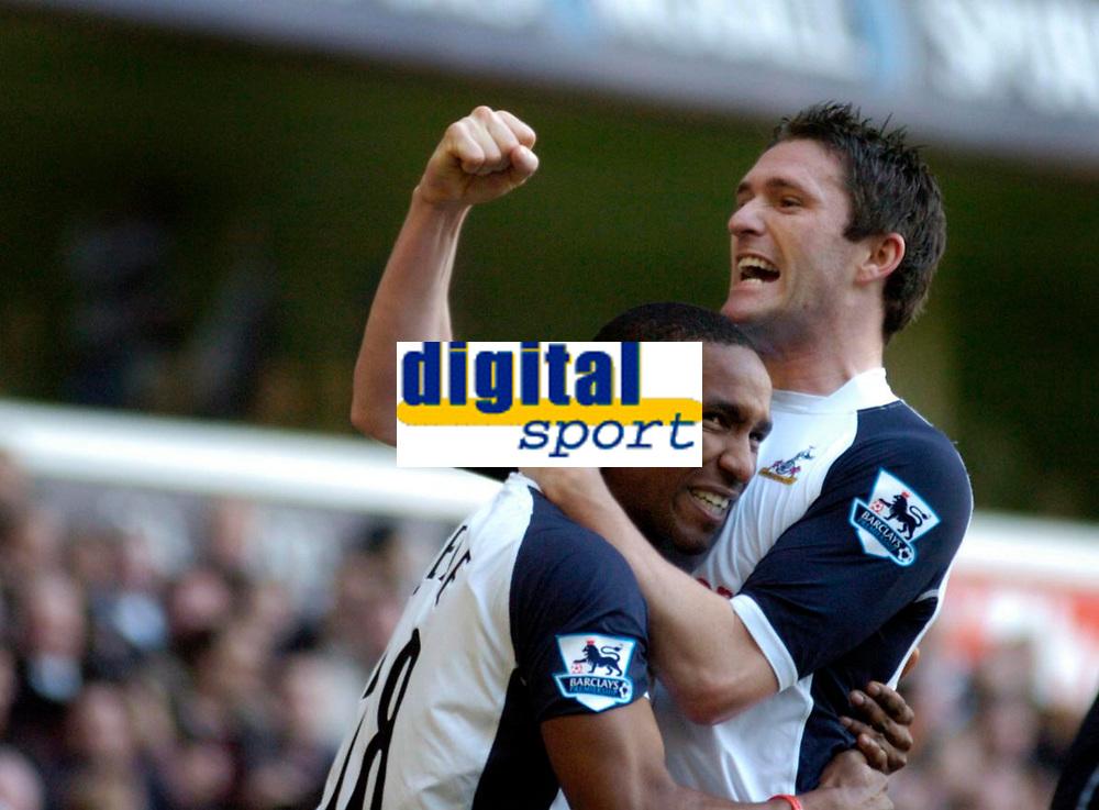 Photo: Leigh Quinnell.<br /> Tottenham Hotspur v Charlton Athletic. The Barclays Premiership. 05/02/2006. Tottenhams Robbie Keane celebrates after Jermain Defoes goal.
