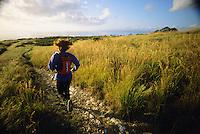 A young woman runs along a trail in Montana de Oro State Park, California.