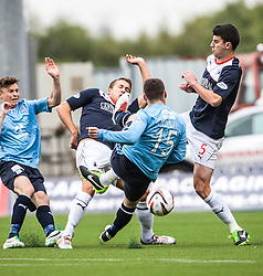 Falkirk's Will Vaulks with Dundee's Carlo Monti and Falkirk's Jonathan Flynn.<br /> Falkirk 3 v 1 Dundee, 21/9/2013.<br /> ©Michael Schofield.