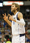 Dirk Nowitzki (41) of the Dallas Mavericks celebrates after a made three-pointer against the Oklahoma City Thunder at the American Airlines Center in Dallas on Sunday, March 17, 2013. (Cooper Neill/The Dallas Morning News)
