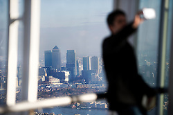 **PICTURES STRICTLY EMBARGOED INTIL 00:01 HOURS FRIDAY 11 JANUARY 2013** © London News Pictures. London, UK.  A man using his phone to take a picture of himself during a media preview of the viewing level of The Shard building in London ahead of the public opening of 'A View From The Shard' on February 1, 2013. The public can view a 360 degree view of the capital from the 72nd floor of Western Europe's tallest building which stands at 800ft (244m).  Photo credit : Ben Cawthra/LNP