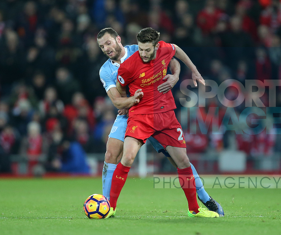 Liverpool's Adam Lallana tussles with Stoke's Erik Pieters during the Premier League match at Anfield Stadium, Liverpool. Picture date December 27th, 2016 Pic David Klein/Sportimage