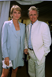 MISS DEBBIE LENG and MR ROGER TAYLOR he is a member of rock group Pink Floyd, at a polo match in Sussex on 20th July 1997.MAM 67