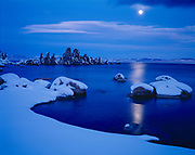 Full moon rising over Mono Lake with snow and tufa towers, Mono Lake Tufa State Reserve and Mono Basin National Forest Scenic Area, Inyo National Forest, California.