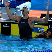 Cesar Cielo Filho, Brazil,  winning the Men's 100m freestyle gold at World Swimming Championships in Rome on Thursday, July 30, 2009. Photo Tim Clayton.