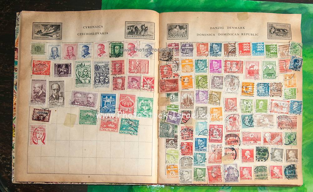 Old stamp album with used cancelled stamps from Czechoslovakia and Denmark