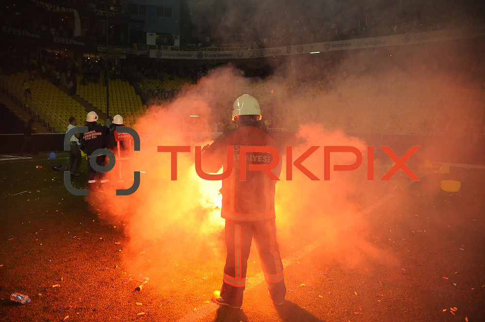 Firemen try to extinguish fire which is set by Fenerbahce supportes after Turkish Super League soccer match between Fenerbahce and Trabzonspor at Sukru Saracoglu Stadium in Istanbul, Turkey, 16 May 2010. Fenerbahce lost the Championship after a draw with Trabzonspor.