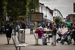 """© Licensed to London News Pictures . 16/09/2020. Bolton , UK . Sign saying """" Don't Mix With Other Households """" in Victoria Square in Bolton Town Centre . The number of recorded cases of Coronavirus has gone over 200 in a single day , in Bolton . Photo credit : Joel Goodman/LNP"""