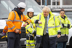 © Licensed to London News Pictures. 18/12/2020. Manchester, UK. British Prime Minister BORIS JOHNSON touches elbows with people on site during a visit to the Open Reach Bolton Training Centre in Bolton . Photo credit: Joel Goodman/LNP