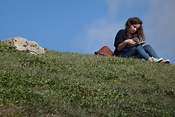 © Licensed to London News Pictures. 02/10/2016. Southsea, Hampshire, UK. A woman reading a book near Southsea Castle in the warm, sunny weather on another stunning autumn day. Photo credit: Rob Arnold/LNP