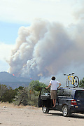 pvc063011i/6-29-11/asec.  Traveler Parker Barry (CQ) of Providence, RI, watches the Las Conchas fire devour a ridge west of Cochiti Lake, photographed Thursday June 30, 2011.  (Pat Vasquez-Cunningham/Journal)