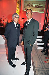 Left to right,  BERNIE ECCLESTONE and LEWIS HAMILTON at the F1 Party in aid of the Great Ormond Street Hospital Children's Charity held at the V&A, Londonon 17th June 2009.