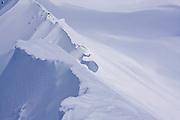 A corniced, scalloped snow ridge below Little Diamond Head, Garibaldi Provincial Park, British Columbia, Canada.