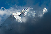 "Sagarmatha National Park: This is the north side of Ama Dablam, a beautiful mountain in the Himalaya range of eastern Nepal, in the Khumbu District. This was photographed between Dingboche and Chhukhung, in the Imja Khola river valley. Ama Dablam was first climbed in 1961. The main peak is 22,349 feet (or 6,812 meters) tall, and the lower western peak is 18,251 feet (or 5,563 meters). Ama Dablam means ""Mother and Pearl Necklace"" (the pearl being the perennial hanging glacier). Sagarmatha National Park was created in 1976 and honored as a UNESCO World Heritage Site in 1979. Published in ""Light Travel: Photography on the Go"" book by Tom Dempsey 2009, 2010."