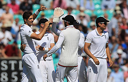 England's Steven Finn, (left) celebrates taking the wicket of Pakistan's Yasir Shah for 26 during day two of the Fourth Investec Test match at The Kia Oval, London.