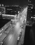 Y-590206-03.  SW 3rd & Oak, looking south. Night view. February 6, 1959.