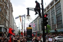 © Licensed to London News Pictures. 01/05/2012. London, UK.  May Day protesters on Oxford Street calling for the end of mandatory non paid work placements. Photo credit : James Gourley/LNP