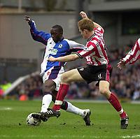 Photo. Glyn Thomas<br />Blackburn Rovers v Southampton. FA Barclaycard Premiership.<br />Ewood Park, Blackburn. 08-02-2003.<br />Blackburn's Andrew Cole (L) sets up the first half goal as he goes past Michael Svensson
